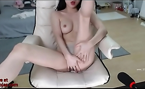 Busty Asian plays with her pussy