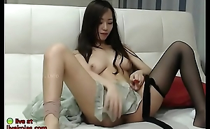 Busty Korean masturbates in pantyhose