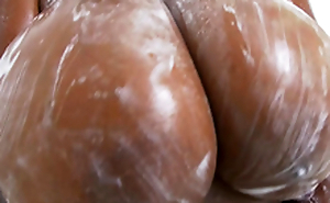 Rachel Raxxx gets her giant tits all soapy plus wet