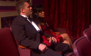 Dark haired bombshell Kaylani Lei gives a handjob to some man thither a theatre